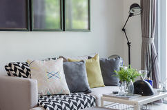 Modern living room with row of pillows on sofa Royalty Free Stock Images