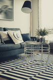 Modern living room with sofa, pillows, lamp and table on graphic Stock Photo