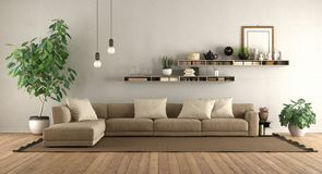 Modern living room with sofa and shelves royalty free stock photography
