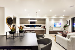 Modern living room with a television beside dinner and kitchen royalty free stock photo