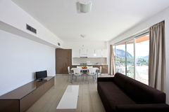 Modern living room. With television and kitchenette Stock Photography