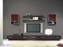 Modern living room with TV and carpet Royalty Free Stock Image