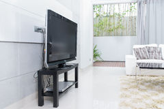 Modern living room with TV and sofa Stock Image