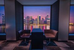 Modern living room with view Singapore skyline at sunset stock images