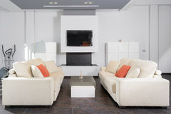 Modern living room in white. Horizontal composition of a modern and elegant living room in white stock photo