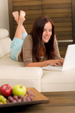 Modern living room woman lying sofa laptop Royalty Free Stock Photography
