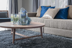 Modern living room with wooden round table Stock Image