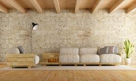 Modern living room wth pallet sofa Royalty Free Stock Photos