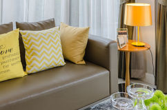 Modern living room with yellow lamp Royalty Free Stock Photography
