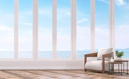 Modern living with sea view 3d rendering image. The Rooms have wooden floors .furnished with wood and fabric furniture.There are white window overlooks to sea Royalty Free Stock Photos