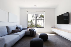 Modern living tv room in a contemporary home. Modern living or tv room in a contemporary home stock photos