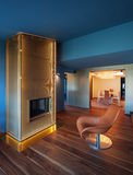 Modern livingroom with gold fireplace, nobody Stock Photos