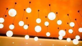 Modern ljus lampa på orange tak Royaltyfri Fotografi
