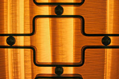 Modern Lobby Detail. This is a modern lobby wrought iron detail in front of a lighted curtain Stock Photo