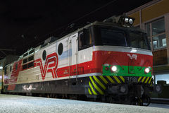 Modern locomotive on the railway station Royalty Free Stock Photos
