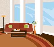 Modern Loft. A stylish livingroom with modern furnishings and expansive windows... in warm natural tones Royalty Free Stock Photography