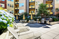A modern loft courtyard with tables and chairs. Stock Photography