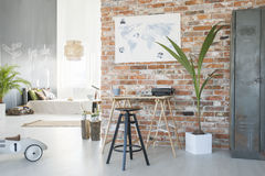 Modern loft design. Modern spacious loft design with brick wall and bed stock photography