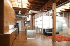Modern loft kitchen. Modern kitchen in a huge loft Royalty Free Stock Photography