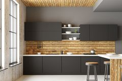 Modern loft kitchen interior. With furniture, appliances, city view and daylight. Front view. 3D Rendering Stock Photo