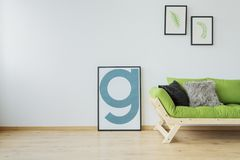 Modern loft with mock-up poster. Minimalist interior design of modern loft with mock-up poster, wooden floor, white wall and green couch stock photos