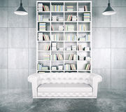 Modern loft room with big white bookcase Royalty Free Stock Photography