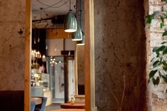 Modern loft style cafe interior in warm colors stock photo