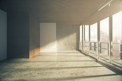 Modern loft style empty room with windows in floor at sunrise Stock Images