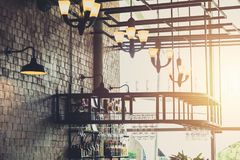 Modern loft style restaurant decoration beer pub and bar. Modern loft style restaurant decoration with hanging light bulb beer pub and bar royalty free stock photography
