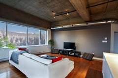 Modern loft with a view. Interior of a modern loft living room with a view Stock Photo