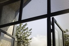 Modern loft window with natural outside view. Stock photo Royalty Free Stock Photography
