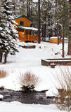 Modern Log Cabin Home In The Winter Woods. New modern log cabin home in the snowy woods of the White Mountains in mid-eastern Arizona, USA stock image