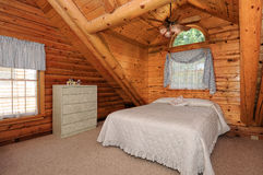 Modern log house bedroom Royalty Free Stock Image