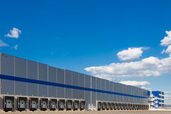 Modern logistics center. Big distribution warehouse with gates for loads and trucks Royalty Free Stock Photography