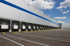 Modern logistics center. Big distribution warehouse with gates for loads and trucks Royalty Free Stock Images