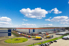 Modern logistics center. Modern warehouse during business hours with a lot of different cargo truck Stock Image