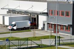 Modern logistics center, white van and trailers standingon ramp Royalty Free Stock Photos
