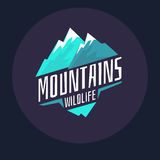 Modern logo mountains with snow in the circle on a dark background. Vector image in flat cartoon style Royalty Free Stock Images