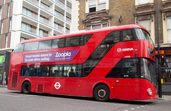 Modern london bus. LONDON - OCTOBER 16TH: London buses at Dalston station on October 16th, 2014 in London, England, uk. Traveling by bus is london cheapest mode Royalty Free Stock Photo