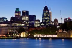 Modern London city office skyline by night Stock Photos
