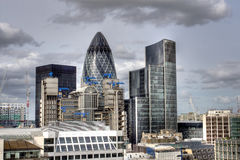 Modern London city skyline office. Modern London city skyline in HDR with Lloyd building and Gherkin and other offices in the background Stock Photography