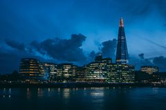 Modern London skyline on River Thames at night. Modern London city skyline on River Thames at night stock photography