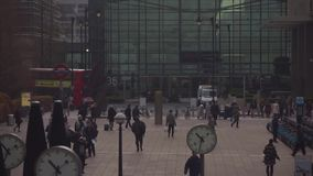 Crowded place full of people moving in time lapse motion on busy downtown street of modern architecture London building. Modern London downtown in time lapse stock footage
