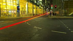 Time lapse view on busy traffic road highway full of bright light illumination flash in evening night London cityscape. Modern London downtown in time lapse view stock video footage