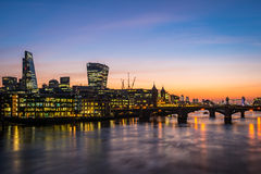 Modern London, morning photo with offices by the river Thames. And illuminated towers Royalty Free Stock Photography