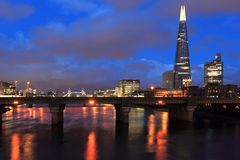 Modern London. The modern London represented by the Shard seen from the bridge in London at night, England Royalty Free Stock Photo