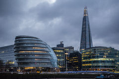 Modern London skyline on moody cloudy evening with rain clouds. Iconic view of the London skyline royalty free stock images