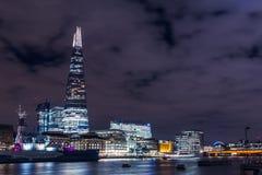 Modern London skyline on River Thames at night. Iconic view of the London skyline at night Royalty Free Stock Photos