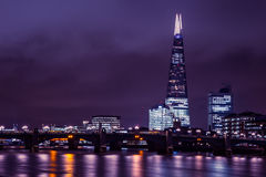 Modern London skyline on River Thames at night with shard buildi Stock Image