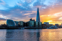 Modern London skyline at sunset Stock Photo